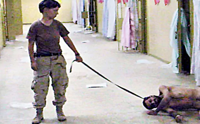 One of the images that show alleged abuses of prisoners by soldiers at the Abu Ghraib prison in Iraq Photo: AP