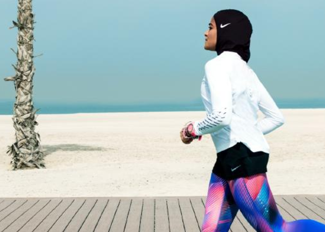 Manual Rostom jogs wearing Nike's new hijab for Muslim female athletes