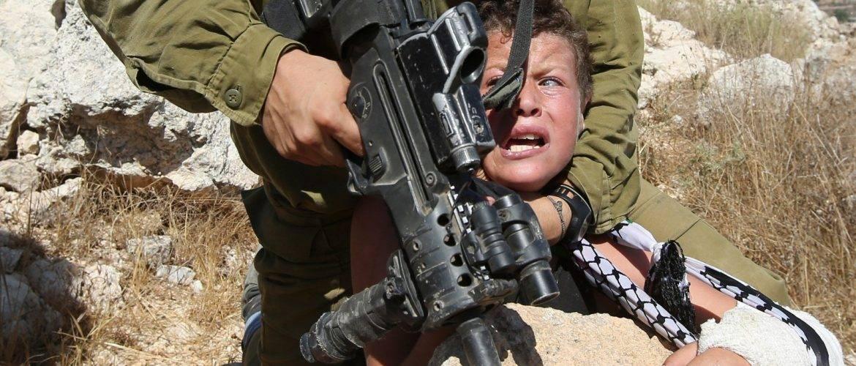 150830073831-01-israeli-soldier-arrests-palestinian-boy-super-tease