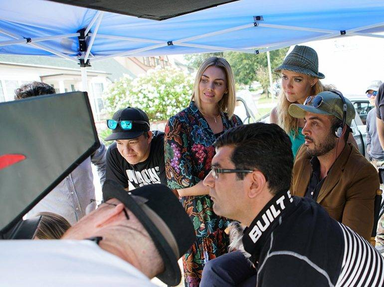 "Sam Khoze, Director Ali Atshani, Taylor Cole and Dominique Swain on the set of the film ""1st Born"""